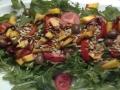 insalata di rucola pesca e semi di girasole
