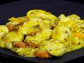 bocconcini di pollo arancia e mandorle tostate